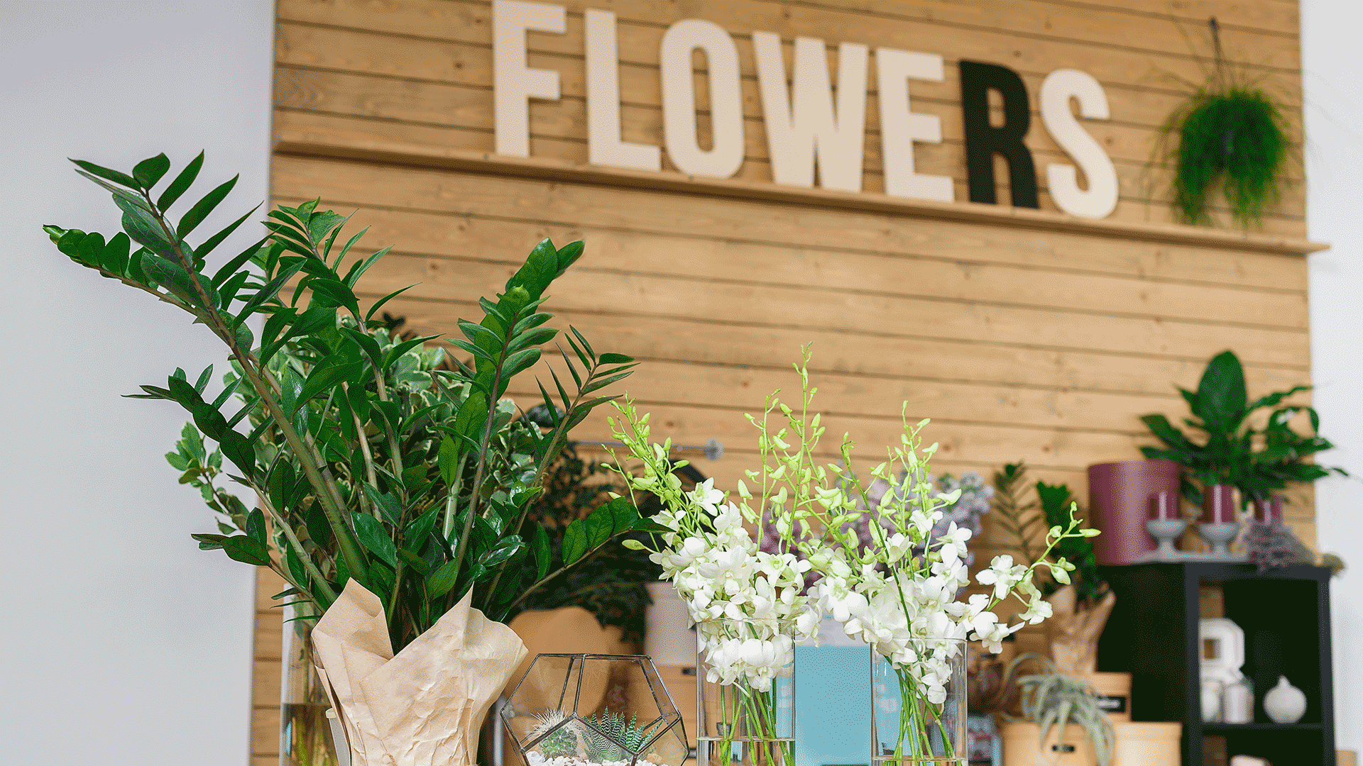 A small business with a sign that reads 'Flowers' in the background.